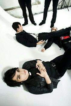 You were so busy looking at Gerard that you completely missed Frank in the background using Mikey as a foot rest