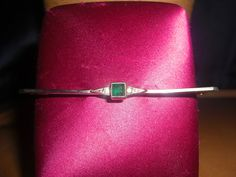 Beautiful Long Antique Art Deco Emerald Glass and Paste Bar Brooch measuring just under 3 inches