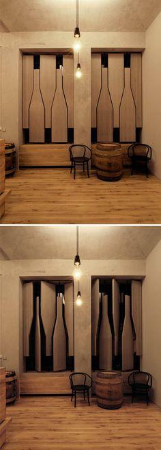 Wine Shop with rotating wine bottle windows / by Aulik Fiser Architekti