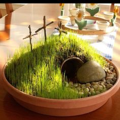 "Plant an Easter garden!   I couldn't link the original post but I HAD to share this.   Using potting soil, a mini flower pot, shade grass seed, twigs and twine for the crosses and some floral rocks.  Once it's ""built"" sprinkle the grass seed on top of the soil. Be generous! Keep the soil moist with a spray bottle several times a day. Should sprout in about 7-10 days so plan accordingly. We will be making these for Easter!   Copied from T. Gust FB page. LOVE!"