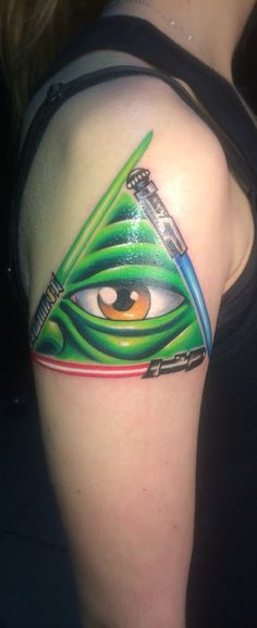 The all seeing eye of yoda! Star Wars tattoo I cannot get over how amazing this is! Even the lightsaber a match up to obi wan, yoda, and darth vader!
