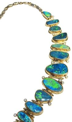 Detail of Opal and Diamond neckpiece in 18K yellow gold by artist Thomas Dailing.