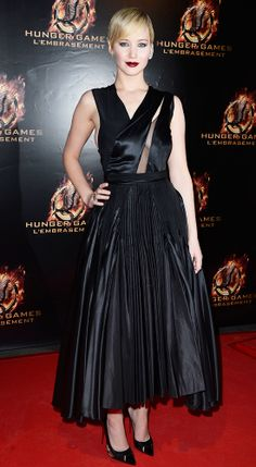 Jennifer Lawrence - At the Paris premiere of The Hunger Games: Catching Fire, Lawrence took everyone's breath away in a black pleated Christian Dior Couture dress with a sheer asymmetric panel that she dramatized with an Ana Khouri diamond ear cuff.