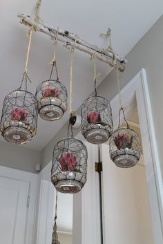 Bundled birch branches with hanging mason jars - These could look lovely hanging outside! Fill with candles perhaps?