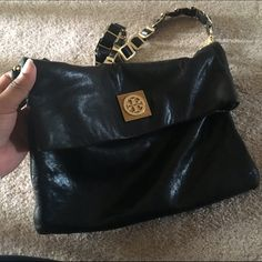 Tory Burch Louisa Used Tory Burch Louisa bag. The leather wears nicely. Can provide additional pictures upon request. Strap can detach to be a cute leather clutch. Sold. Out. No tassel. Tory Burch Bags Clutches & Wristlets