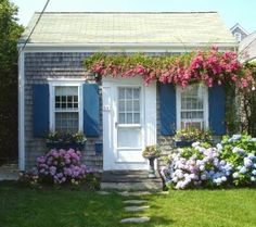 *I can just imagine how cute this little cottage is on the inside. Shabby/Vintage Cottage Love.