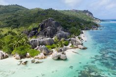 This place is one of the most scenic beaches in Seychelles, with its beautiful mix of turquoise waters, golden sands and gigantic boulders. Can anyone guess the name of this picturesque beach? Seychelles Islands, Turquoise Water, Another World, Honeymoon Destinations, Sounds Like, Beach Photos, Sands, Bouldering, Palm Trees