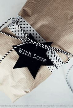 Wrapping love this idea.  no tutorial.  Just printed cut out, ribbon, baker's twine & craft paper