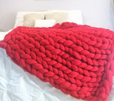 Chunky Knit Merino wool blanket in red color, one of the very popular colors  Colors in picture: Red Size in the picture: Red: 40x60 Measurements may change within a few inches due to the natural shift in the yarn Every stitch is three inches  Ready for shipping within 2-3 days.  Watch our video about sizes of the blankets to make the right choice: https://youtu.be/0j8Lpdk-W54  Any custom size is avalable  This beautiful super chunky knit blankets are super soft and warm, you w...