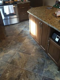 Wood Floor Into Stone Transition DoItYourself Com . Home Flooring Masters Professional Remodelers. Home and Family Karndean Flooring, Vinyl Plank Flooring, Kitchen Flooring, Tile Flooring, Dark Wood Tv Stand, Armstrong Flooring, Luxury Vinyl Plank, Cool House Designs, Engineered Wood