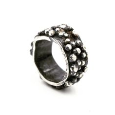 #contemporaryjewelry ...  Sterling silver ring, set with silver granules