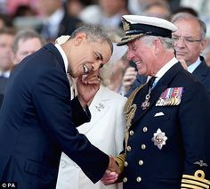 Prince Charles breaks out in laughter as he greets US President Barack Obama during the international ceremony.