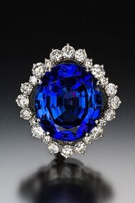 Sapphire And Diamond Ring normally I dislike this color of ring, but this is striking and beautiful