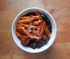 Baked Pasta alla Norma...penne with sausage, tomato sauce, fried eggplant, whipped ricotta and fried garlic