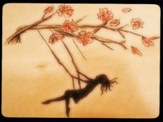 Girl swinging on the tree