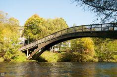 Wooden pedestrian bridge across the river Rur in Heimbach (Eifel region).