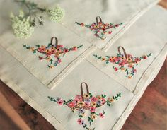 Check out this item in my Etsy shop https://www.etsy.com/uk/listing/469263662/hand-embroidered-floral-baskets-linen