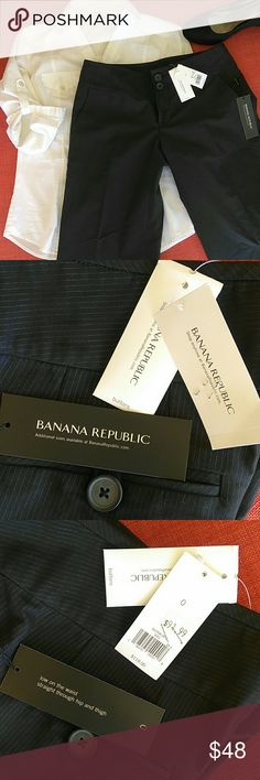 "NWT Banana​ Republic size 0 dress pants strt leg These black NWT dress pants have tiny silvery blue pinstripes. The tag says ""low on the waist straight through hip and thigh"". There are initials penned onto the tag as shown in the picture, but they were only tried on. They are 85% cotton and 15% rayon. Extra buttons are still attached in a small envelope. Banana Republic Pants Trousers"