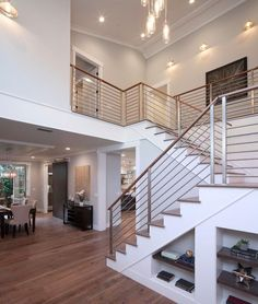 Contemporary Staircase with Modern Interior Railing, High ceiling, Crown molding, Metal staircase, Hardwood floors