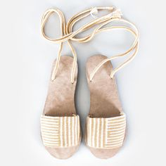 Crochet wrap-around sandals with a modern design. Features handmade crochet upper, crossover ankle straps, leather lining, and rubber sole. Made by artisans from La Guajira Material: Cotton, leather a