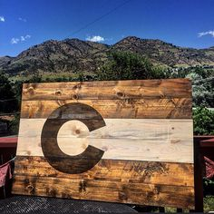 Handmade with love from Colorado Woodcraft - rustic Colorado flag made from locally harvested and repurposed Lodgepole pine Beetle kill. Made in beautiful Golden, CO. #coloradowoodcraft