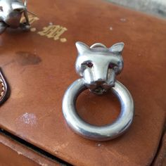 Rare and Vintage tiger silver earrings. Very elegant, rare silver earrings bought in an Antique store in Paris. Brand unknown. Eyes may be made of rubies.. Maybe Cartier? No sign of brand mark. No brand Jewelry Earrings
