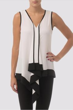 Joseph Ribkoff's dual tone tunic features sleeveless construction with high-contrast trim and lengthy ruffled detail down the front. The v-neck gives a feminine look while the kerchief hem hits past the hip. Tunic by Joseph Ribkoff. Clothing - Tops - Sleeveless Massachusetts