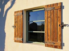 Love these shutters southwestern window shutters for Spanish style interior shutters