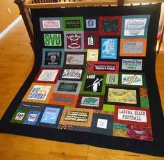 *tshirt quilt, cut close to logos so all squares are different, with fabric borders around each shirt piece. Quilted around all edges.