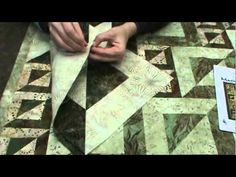 MAGIC SQUARES QUILT video tutorial. Very easy clever way to cut these blocks using simple log cabin squares, double sewn down diagonal center and cut apart. Quilt is three sizes of these blocks. Great dimensional effect. Takes 3 darks, 3 lights and border. Love the artsy look of this quilt!