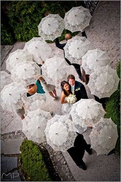 What to do if it rains on your wedding day!   Bridal party under umbrellas!   cpbride.com/blog
