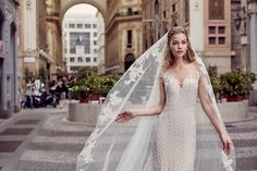 Eddy K Milano Style MD233. Available @ Low's Bridal.