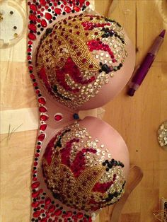 Work in progress on a full rhinestoned bra. Red black gold. Contact Glorious Pasties dot com or FB page