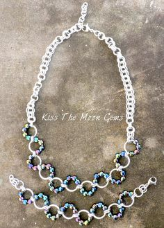 Beautiful 2 piece aluminum chainmaille set. Made with high quality silver colored aluminum jump rings and TOHO seed beads in purple iris color. They have a wonderful rainbow finish to them. The necklace is choker length at aprox. 17 inches long and the bracelet is aprox. 6 1/2 inches long.