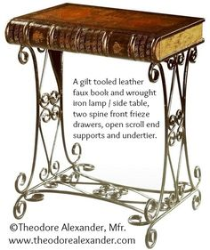 "Victorian-Style. Trompe L'Oeil Book. End Table. ""A gilt tooled leather faux book and wrought iron lamp / side table, two spine front frieze drawers, open scroll end supports and undertier."" © Theodore Alexander, Mfr.  http://www.theodorealexander.com/ Copyright law requires that you 1. Credit the artist, 2. List/Link directly to artist's website. COPYRIGHT LAW: http://pinterest.com/pin/86975836525792650/  REAL LIFE:  http://pinterest.com/pin/86975836525987875/"