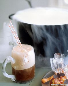 [witches' brew] rootbeer floats out of a cauldron with dry ice!