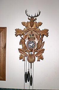 Vintage Black Forest Hunter Carved Cuckoo Clock Dancers Deer Elk Fish Mine is a 1 door and only has 2 pinecone weights. My Great Uncle Kenny got it in Germany when he was serving