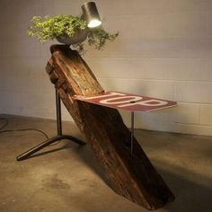Modern farmhouse lighting! A table which has a reclaimed wood beam, a dairy farm pipe, a cattle-watering trough, plus an old stop sign to top off the mix... So,Beam Table or Farmhouse Floor Lamp? #Concept #Diylighting #Farm #Farmhousedecor #Floorlamp #Handmadelighting #Lamp #Led #Lighting #Lightingdesign #Modernlighting #Reclaimedwood #Recycle #Rusticlighting #Tablelamp #Woodbeam #Woodlamp #Woodworking