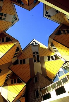 Netherlands Cubic Houses in Rotterdam. Architect Piet Blom turned a parallelepiped an angle of 45 degrees and put a hexagonal pylon at an angle along with it. The houses have three floors. The entrance is on the ground floor, a guest room with a kitchen is on the second floor and two bedrooms and a bathroom are on the third floor. A small garden is sometimes placed on the upper floor.