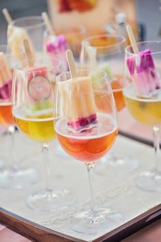 Add a popsicle to a fruity cocktail for a cool twist on your signature wedding drink! {Photo courtesy of Debbie Kennedy Events & Design}