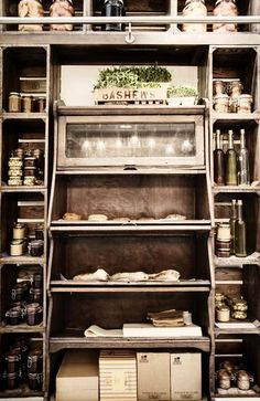 nice display of bread/food within a feature storage/wall setting
