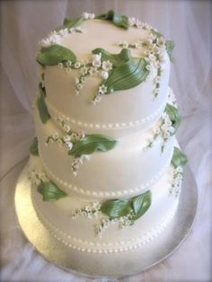 Lily of the Valley wedding cake - Lily of the Valley is my favorite flower! My mimi used to pick it for me when I was little. This might be an idea! Elegant Wedding Cakes, Elegant Cakes, Beautiful Wedding Cakes, Gorgeous Cakes, Wedding Cake Designs, Pretty Cakes, Amazing Cakes, Bolo Cake, Piece Of Cakes