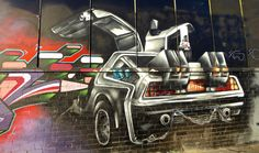 https://flic.kr/p/QSFHfD | Sheffield Street Art | Back 2 the Future - Sylvester Street  Colourful street art on the facade of the old Russell Bros. building on Sylvester Street. One of the many artworks currently present includes a representation of the DeLorean used in the Back to the Future movies.