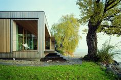 Solar-powered House Lindau blends in with its lakeside surroundings in Germany | Inhabitat - Sustainable Design Innovation, Eco Architecture, Green Building
