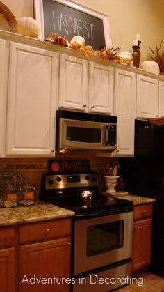 I love the idea of a chalk board above the cabinets - it can be changed for each holiday / season :)