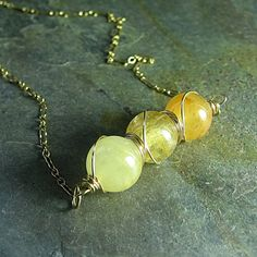 Spun Gold - Ombre bar necklace with a trio of honey quartz beads wrapped in gold-fill wire.    ...from LavenderCottage on Etsy