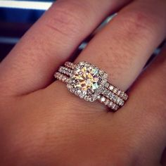 Halo engagement ring with rose gold wedding bands