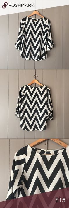 "Black & White Chevron Top from Everly✨ Super cute top in excellent used condition. Roll tab sleeves. Armpit to armpit is 18"". Length is 25"". Offers are welcome. ☺️ Nordstrom Tops Blouses"