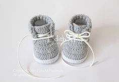 Crochet baby booties, crochet baby shoes, unisex baby booties, unisex baby sneakers, baby trainers, white, grey, gray, gift for baby, idea by EditaMHANDMADE on Etsy https://www.etsy.com/uk/listing/526718517/crochet-baby-booties-crochet-baby-shoes