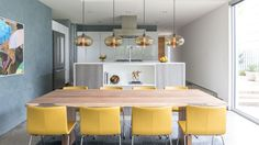 Niche modern pendant lights create the perfect centerpiece in this Dallas dining room designed by Cantoni.